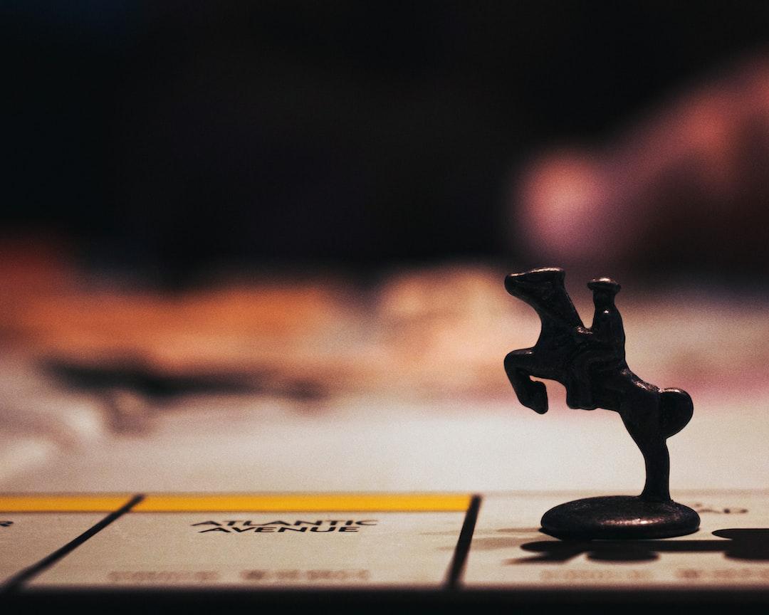 black wooden figurine on white paper