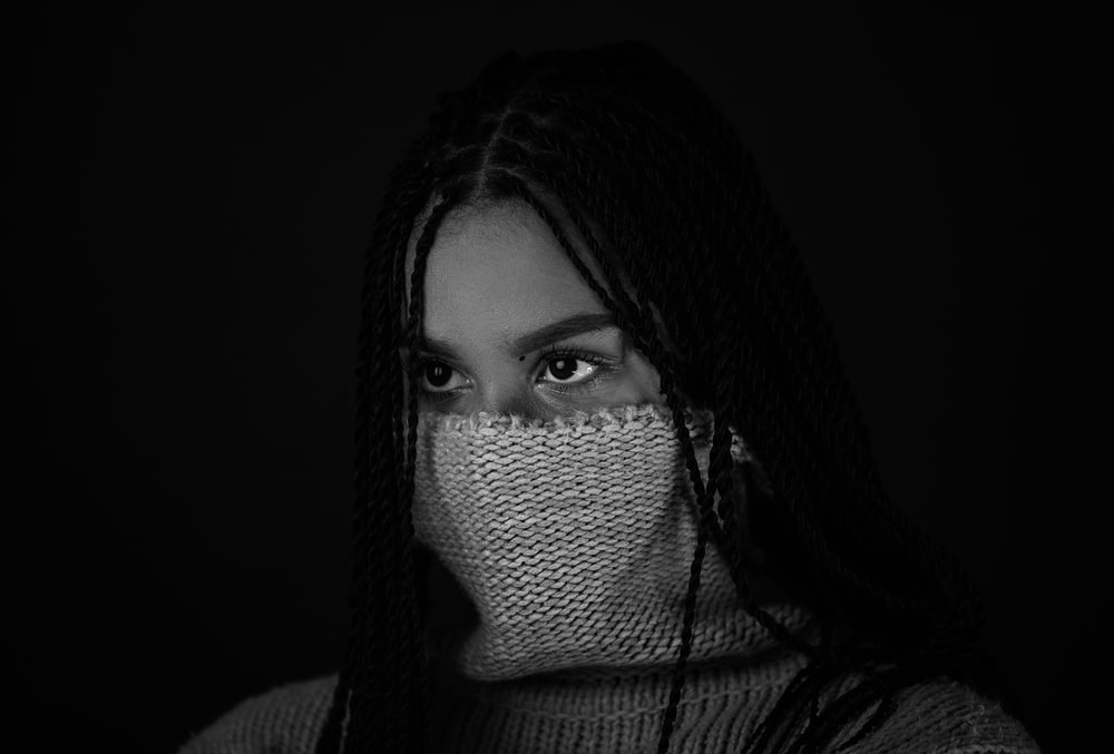 woman with black hair covering her face