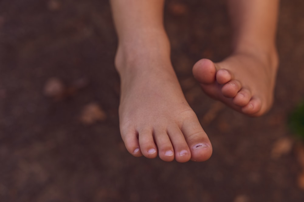 persons feet on black surface