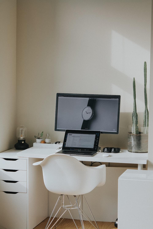 black laptop computer on white table