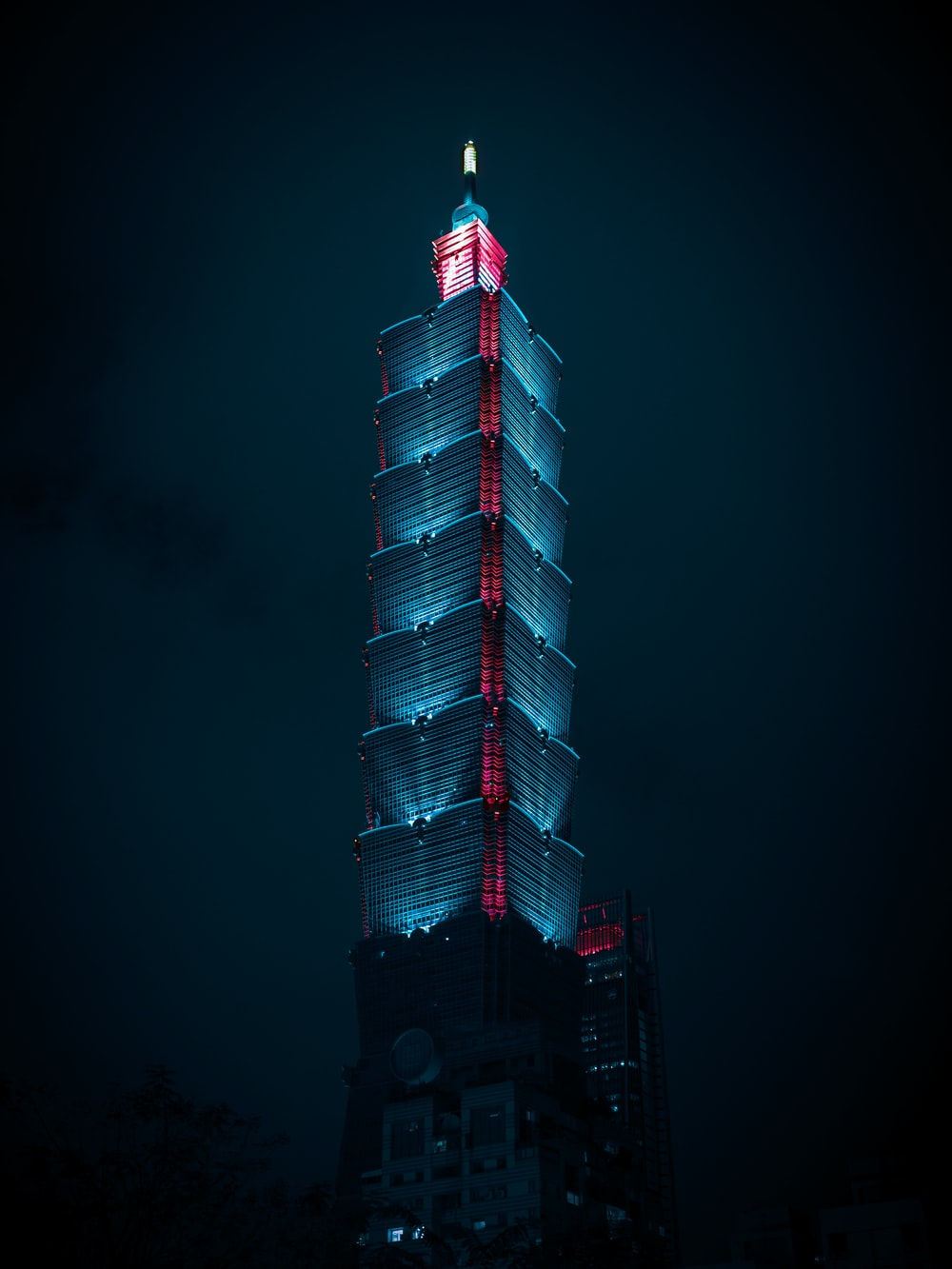 red and white tower during night time