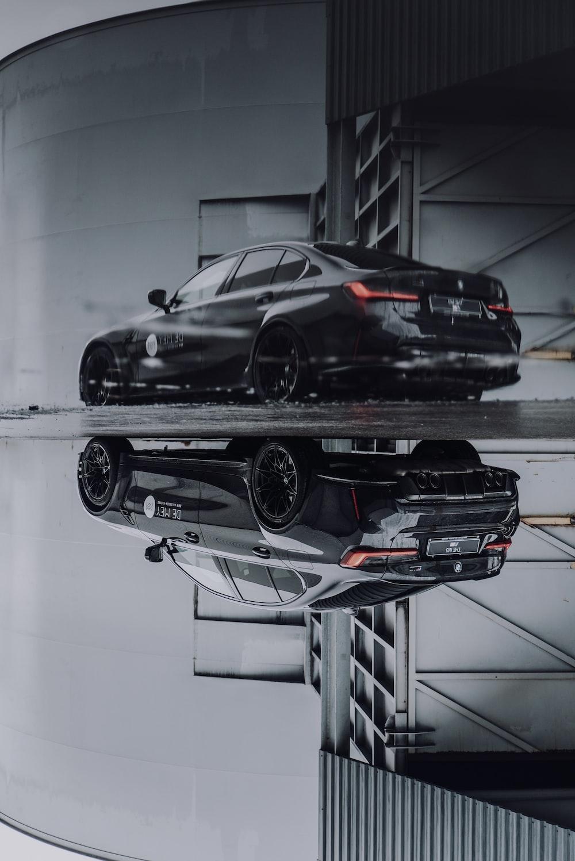 black coupe on white floor