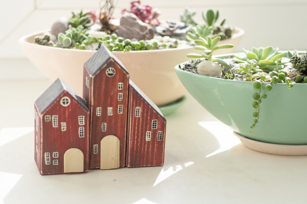 brown wooden house miniature on white table