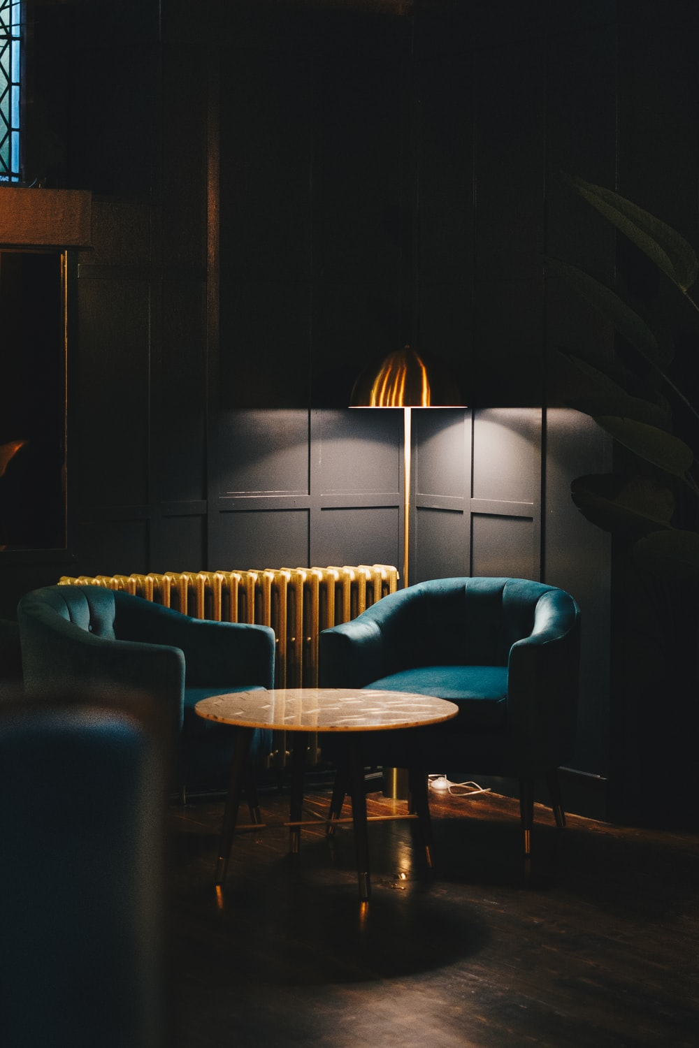 blue sofa chair beside brown wooden table