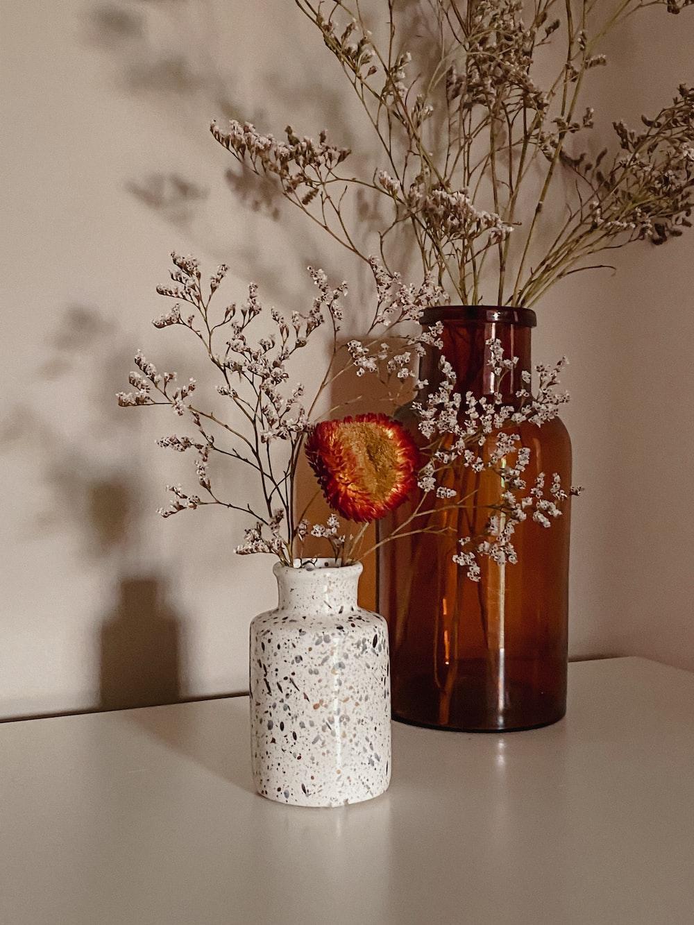 red flowers in white ceramic vase