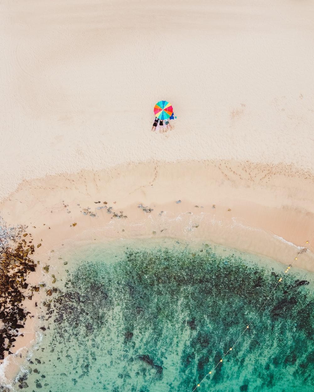 people riding ski lift on beach during daytime