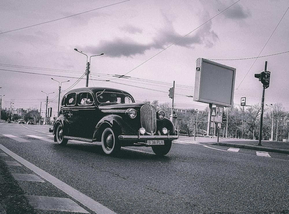 black vintage car on road during daytime