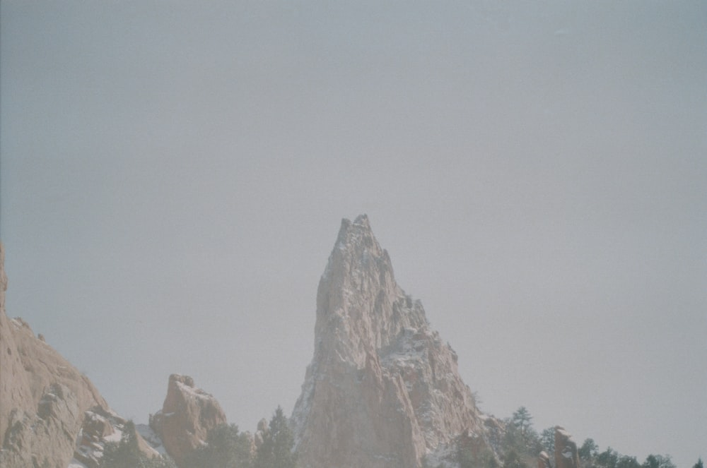 brown rocky mountain under white sky during daytime
