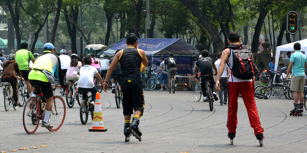 people riding bicycle on road during daytime