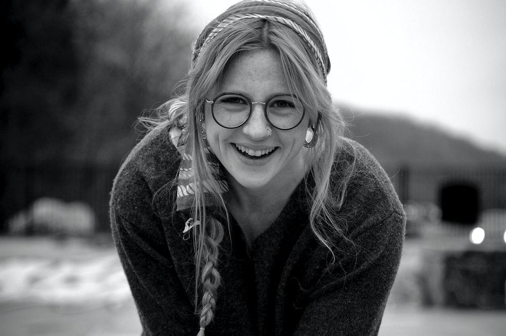 woman in black jacket smiling