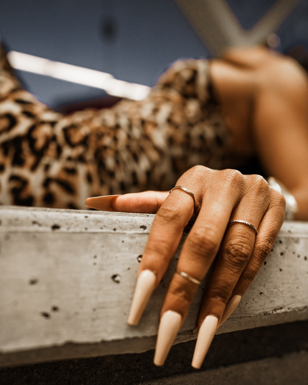 person with brown manicure on white wooden table