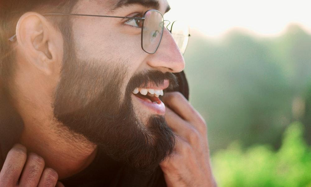 man in silver framed eyeglasses