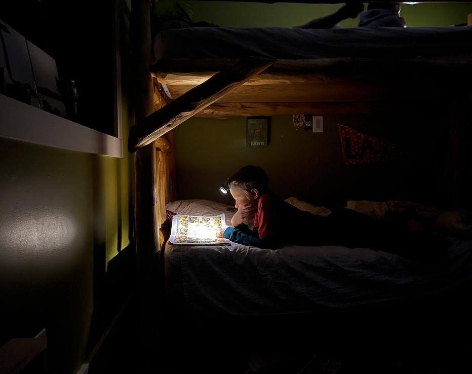 child using headlamp camping