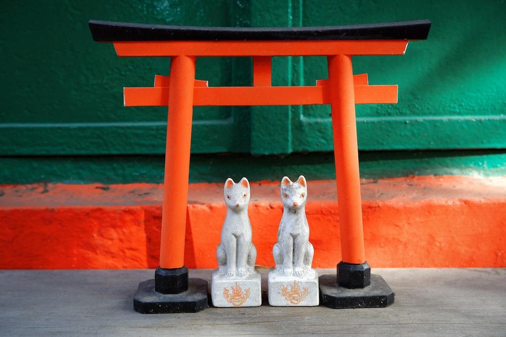 white cat and cat ceramic figurines