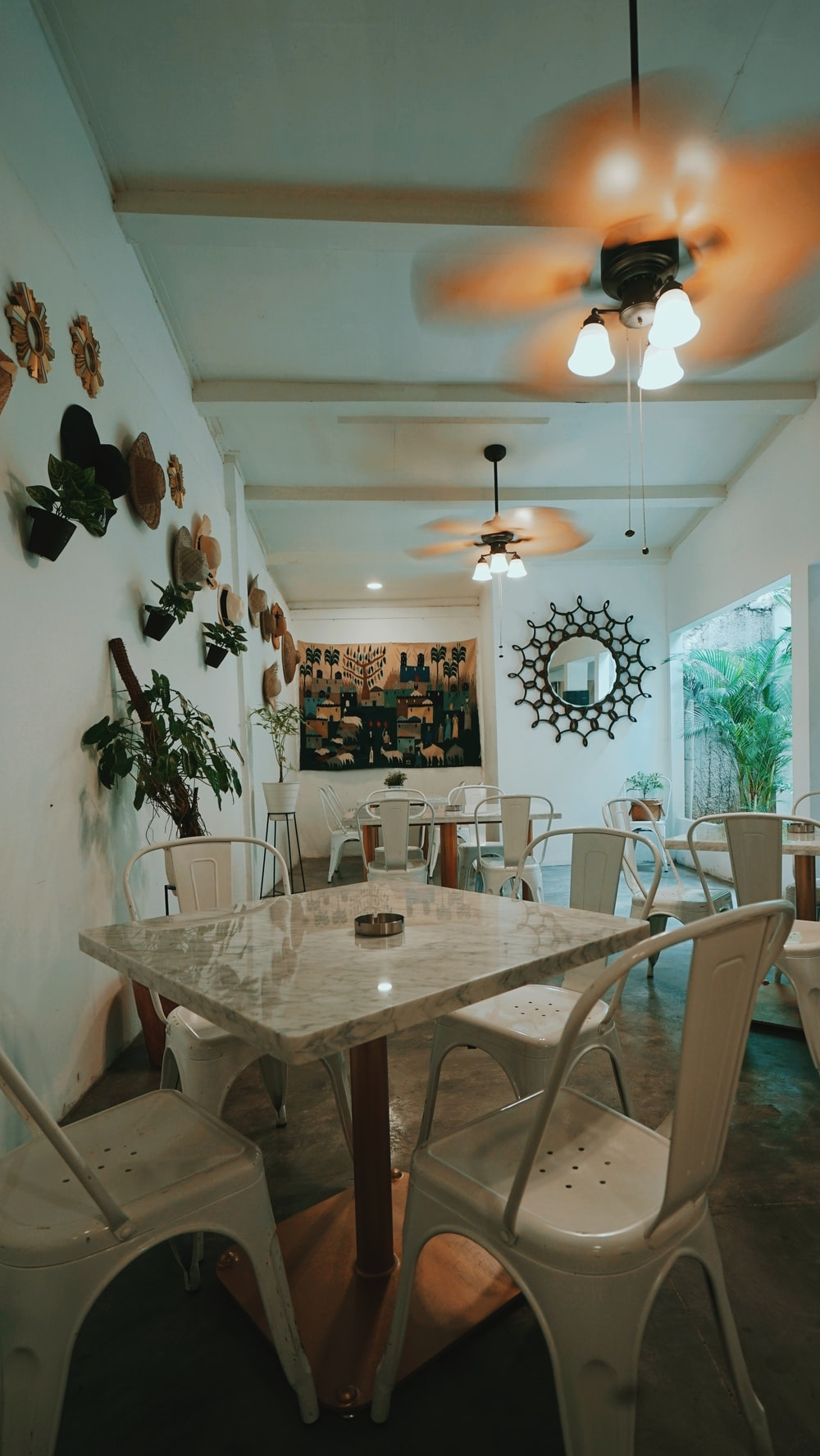 white and brown wooden dining table and chairs