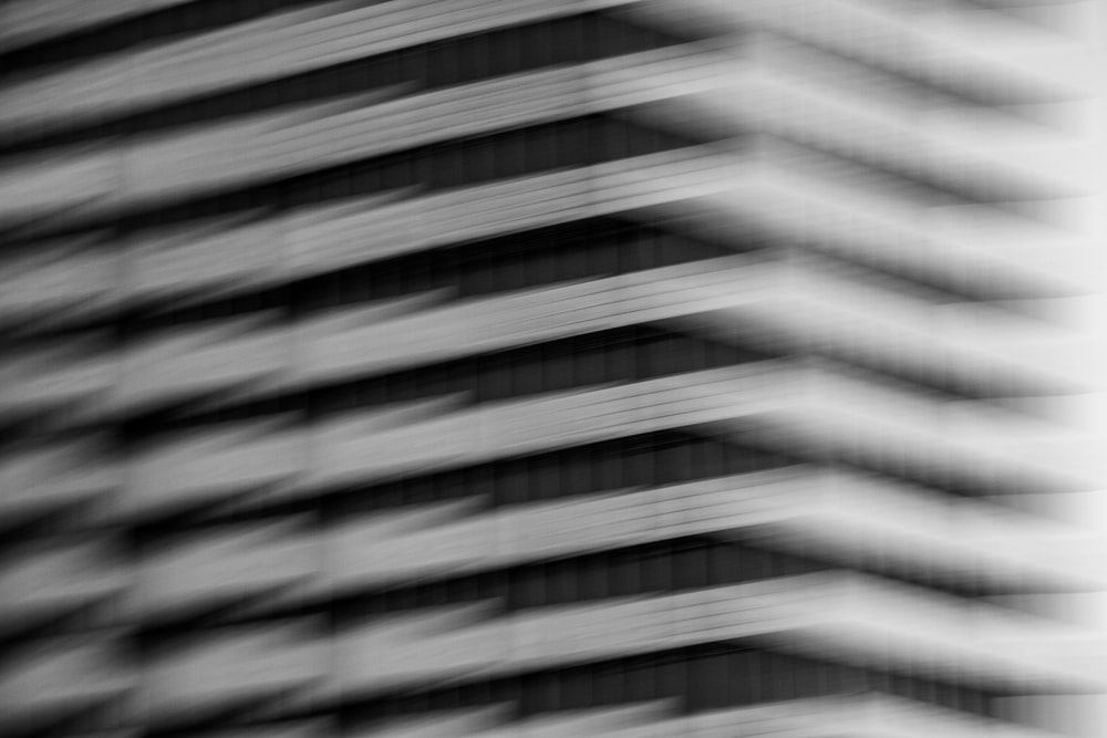 grayscale photo of a window blinds
