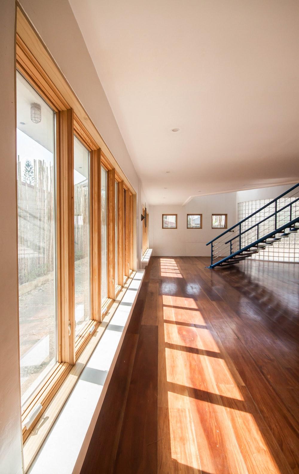 brown wooden parquet floor with glass windows