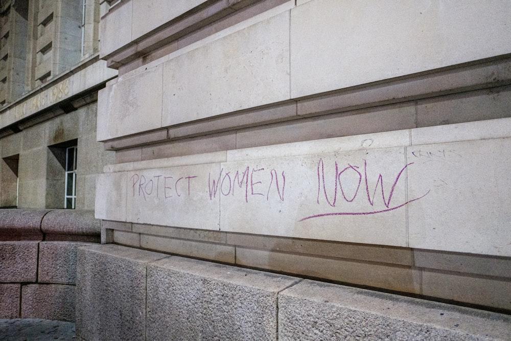 white concrete wall with graffiti