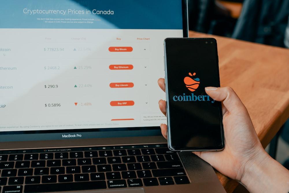 black iphone 7 plus on macbook pro
