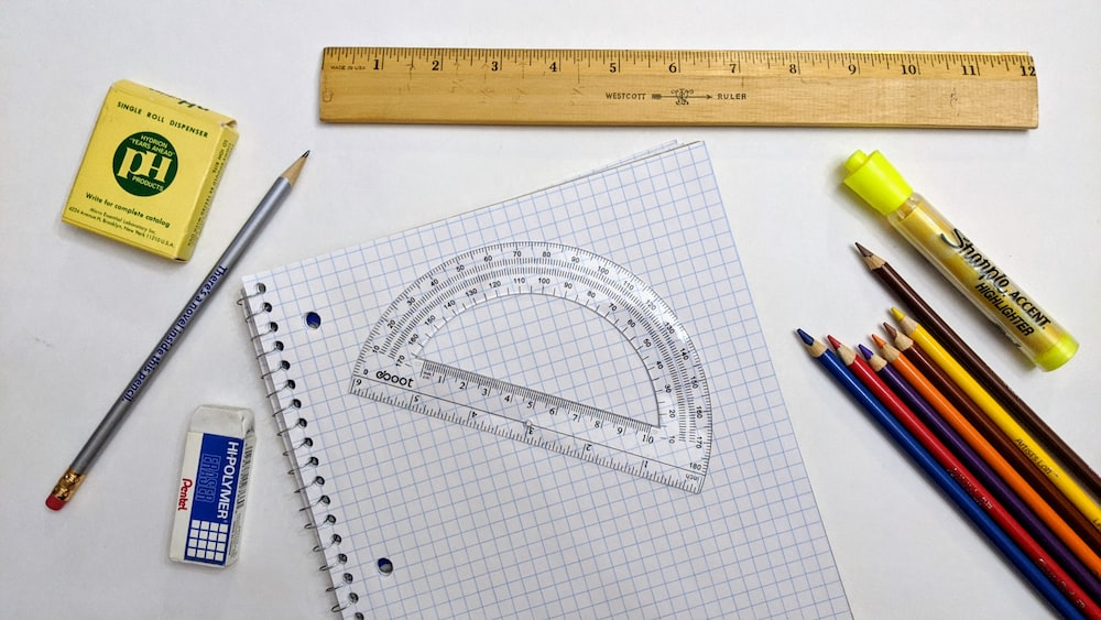 white graphing paper with black pen
