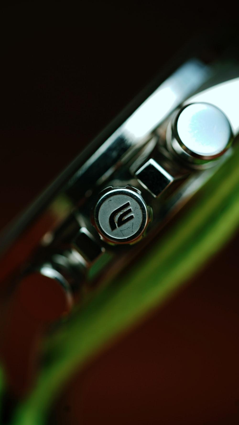 green and silver door lever