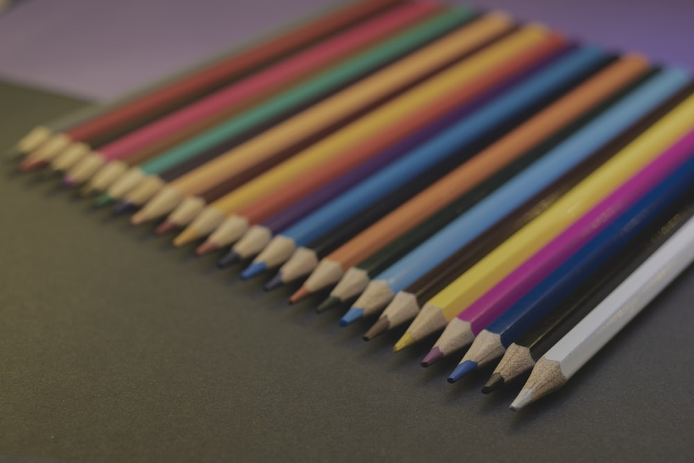 multi color coloring pencils on brown surface