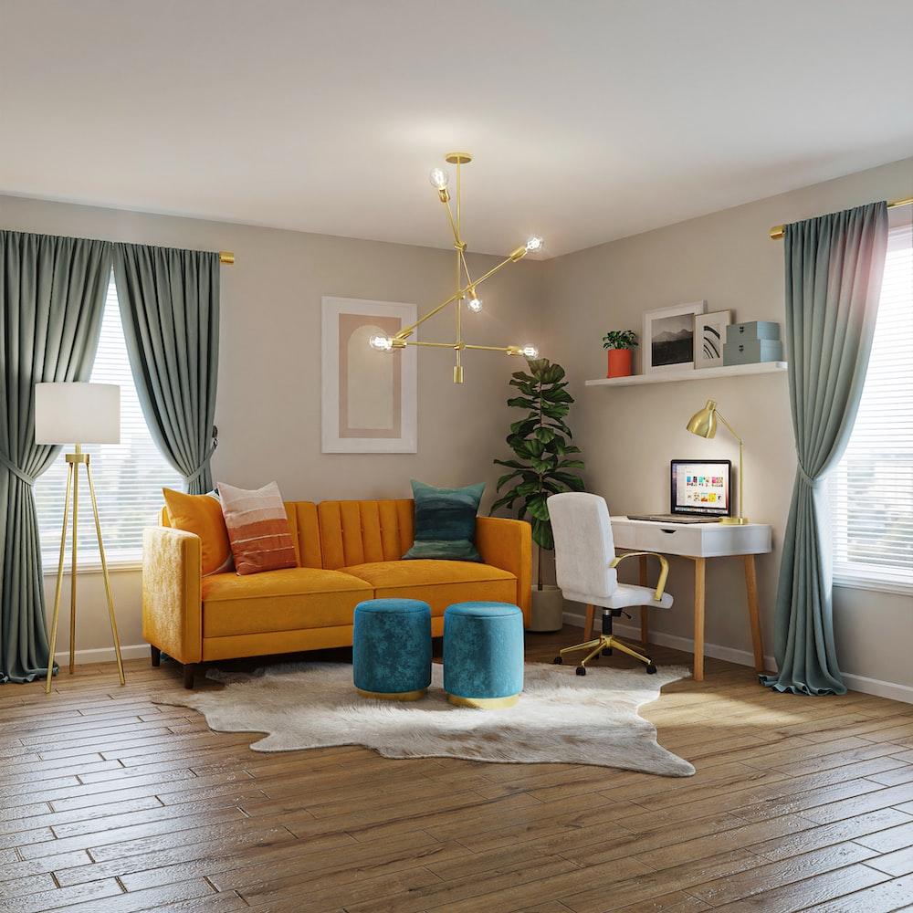 brown sofa near white table lamp