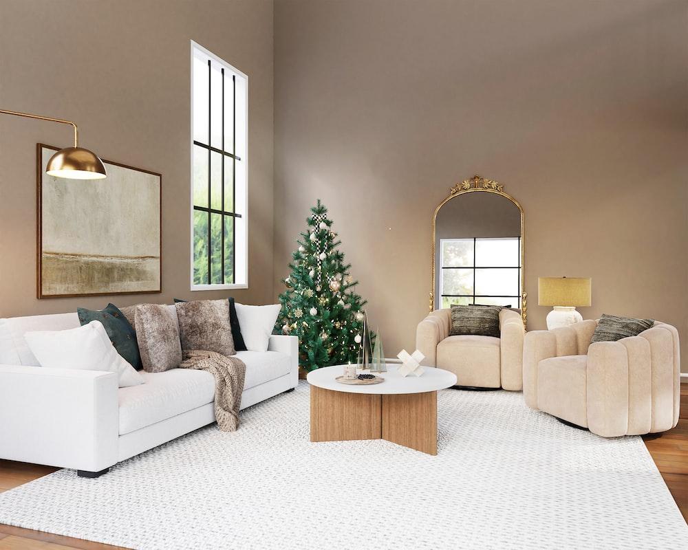 white sofa near green christmas tree