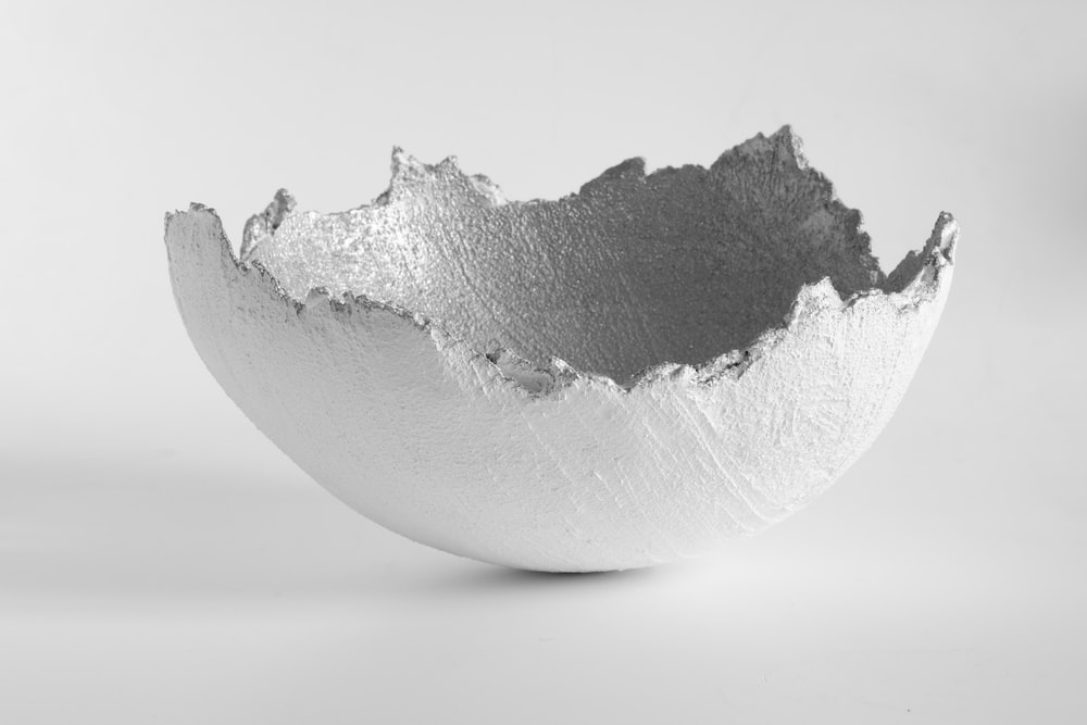 white and gray stone on white surface
