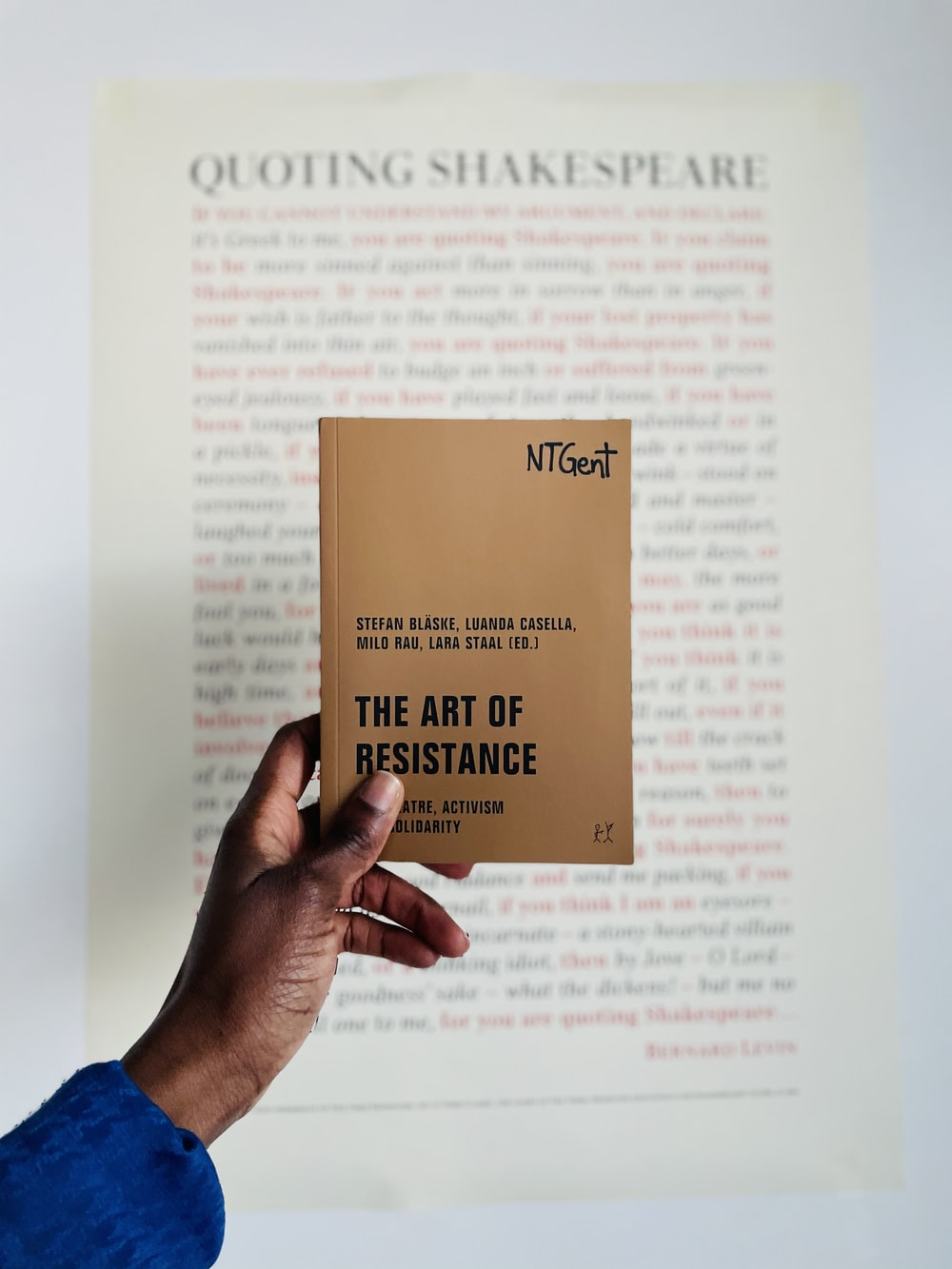 person holding brown and white book page