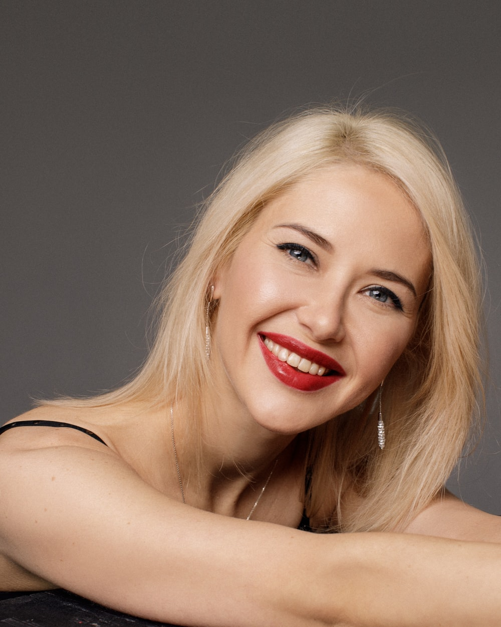 woman in red lipstick smiling