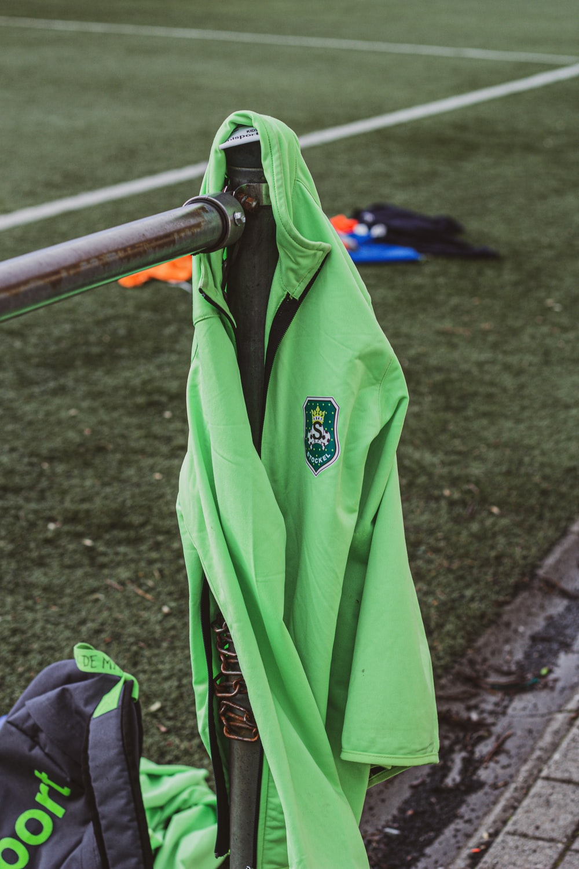 green and black zip up jacket