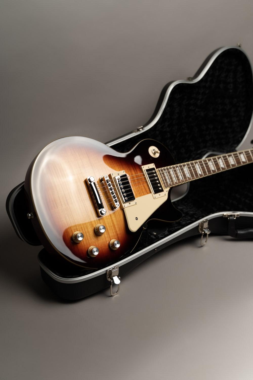 brown and black electric guitar