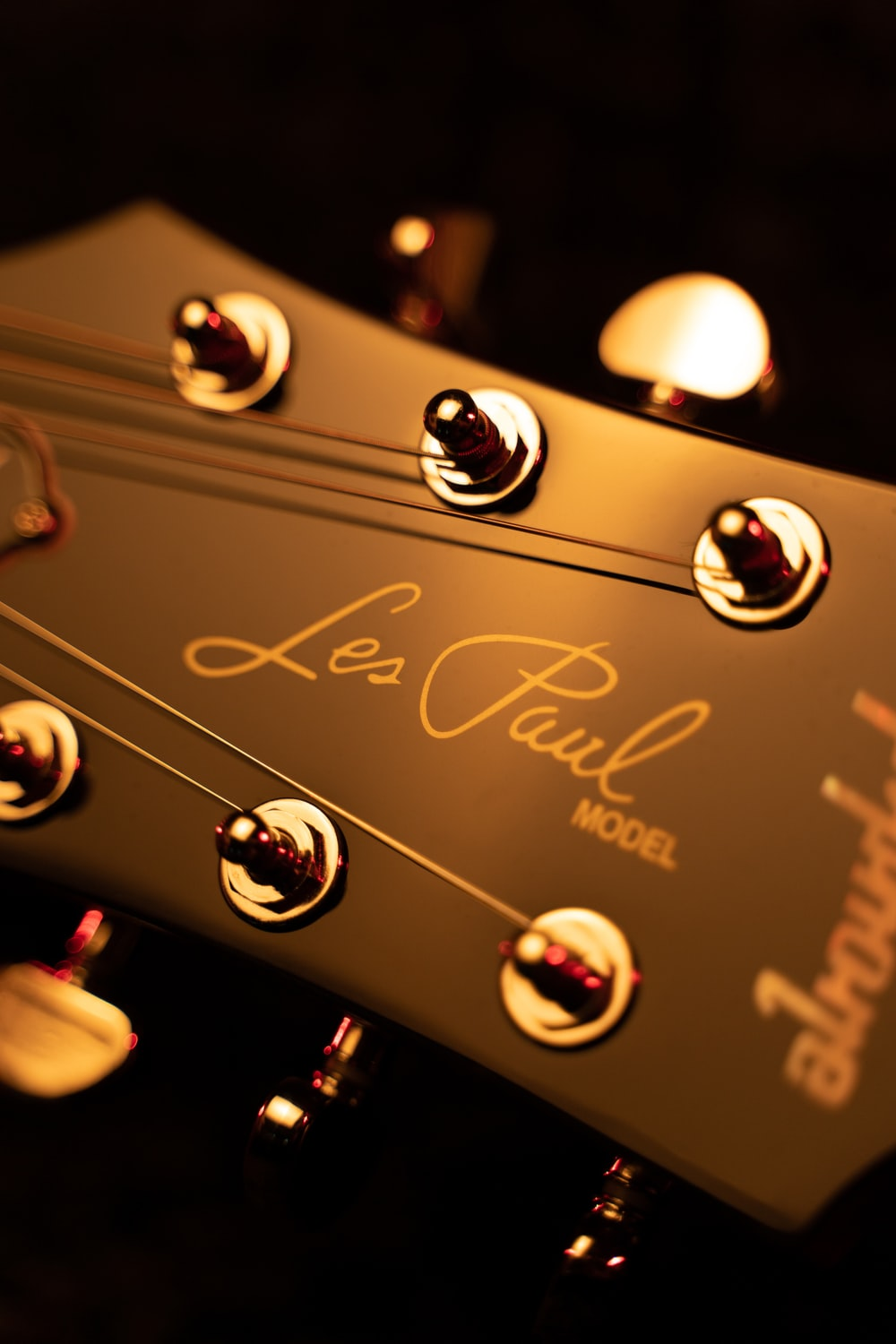 brown guitar headstock in close up photography