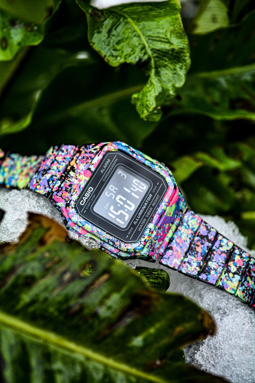 silver and purple digital watch