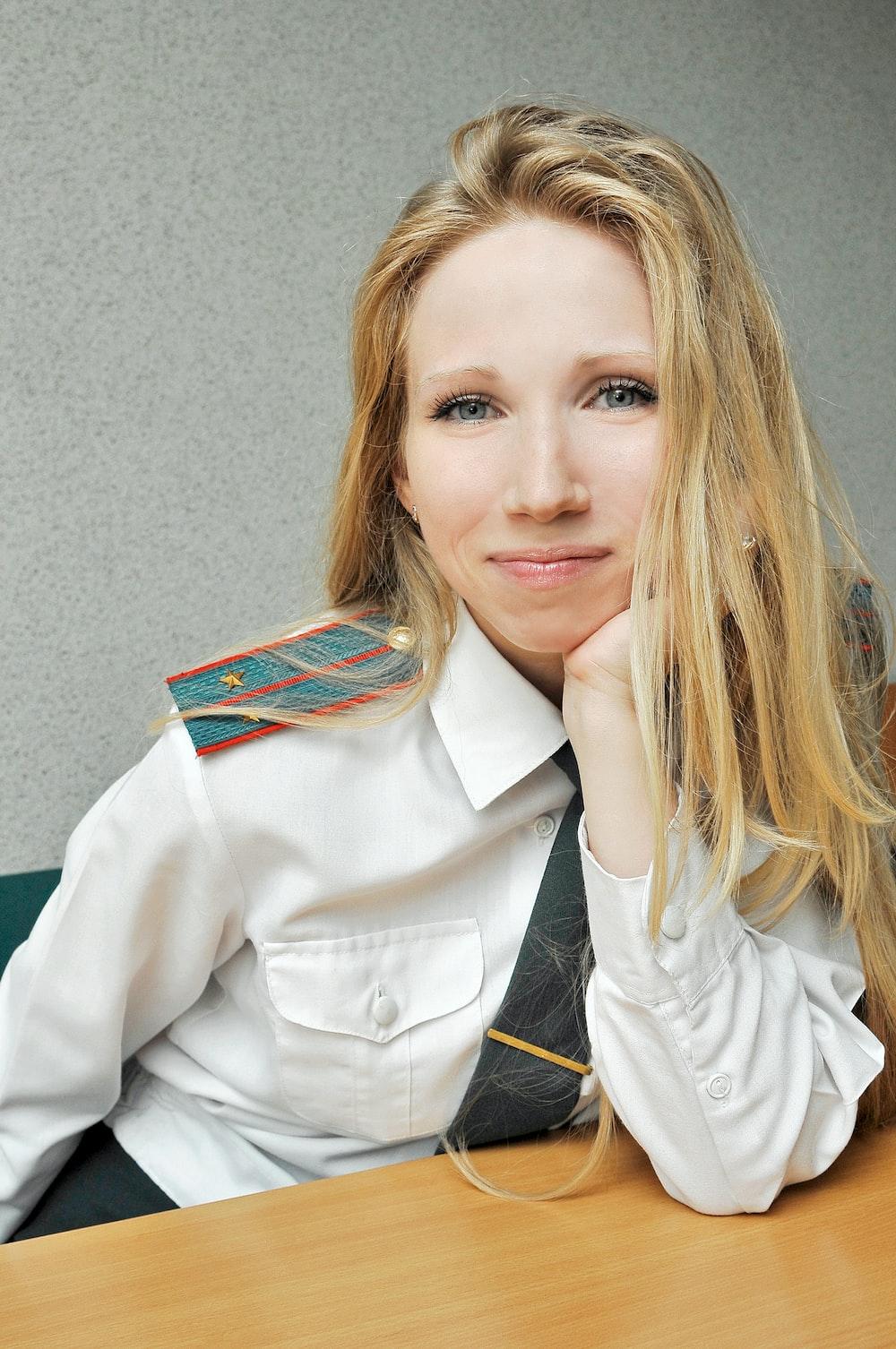 woman in white blazer smiling