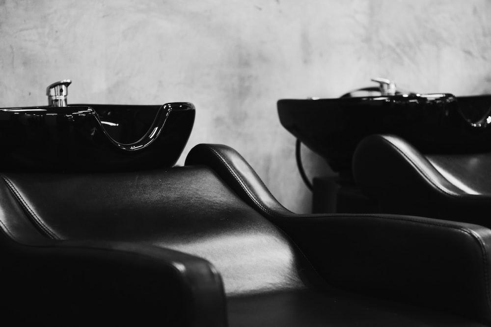 black sunglasses on black leather chair