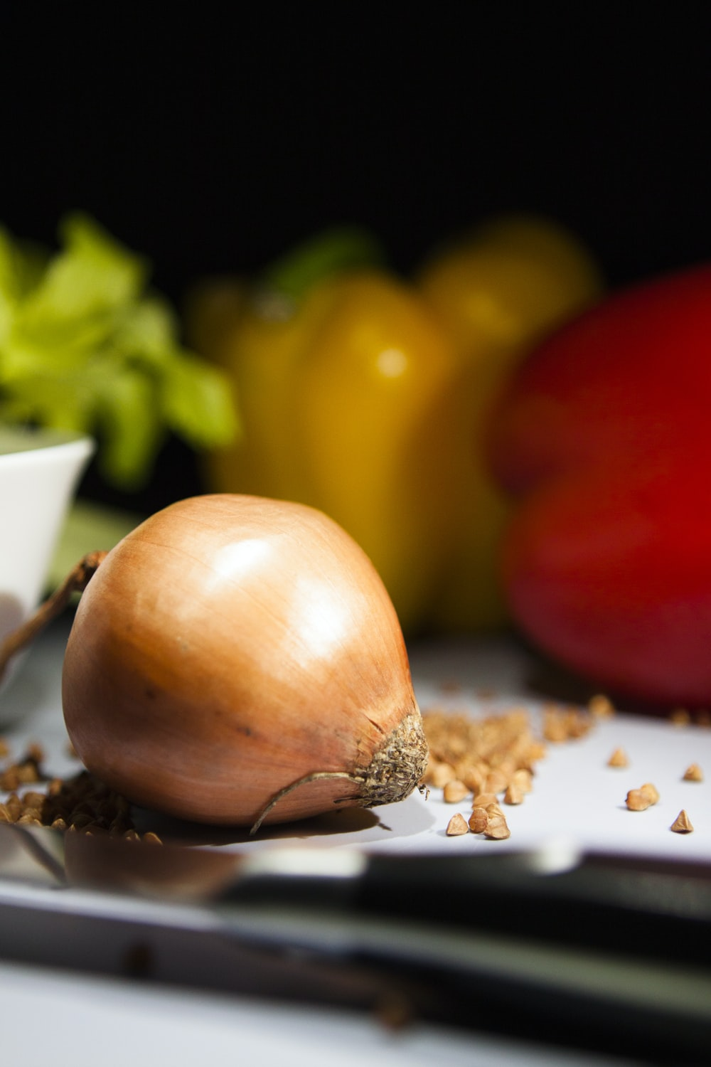 brown onion on white paper