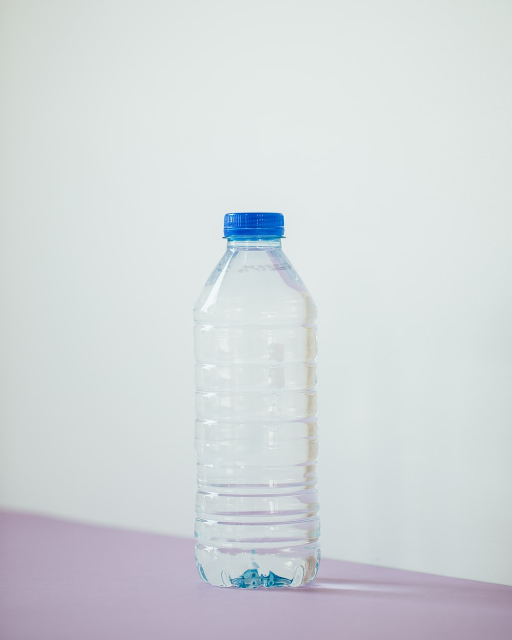 clear plastic bottle on white table