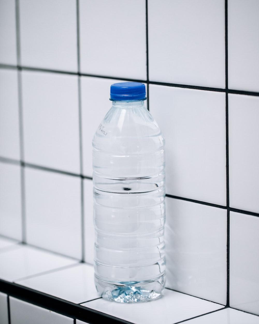 clear plastic bottle on white ceramic tiles