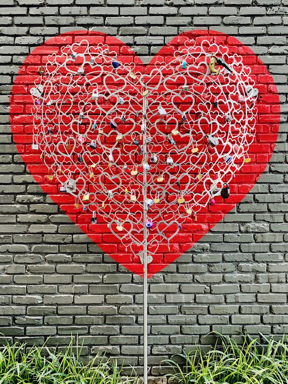 red heart shaped balloon on brown brick wall