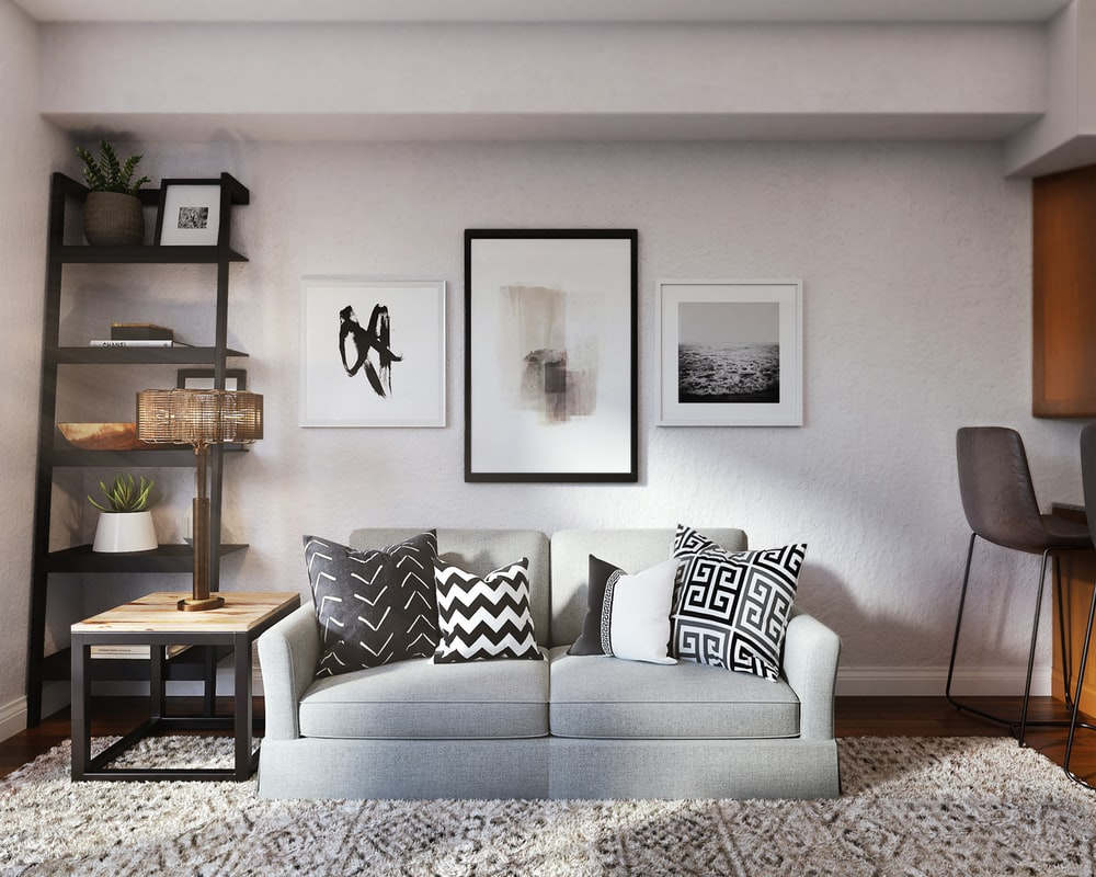 white and black throw pillow on white couch