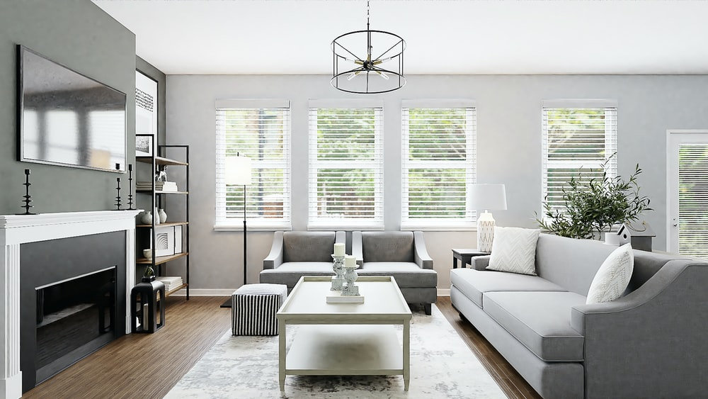 white sectional couch beside white wooden table