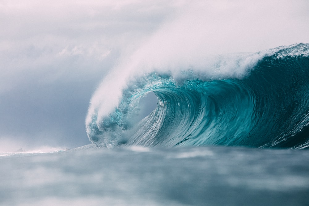 white and blue ocean waves