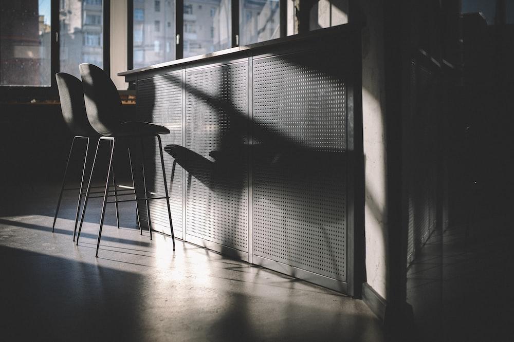 person sitting on chair near window