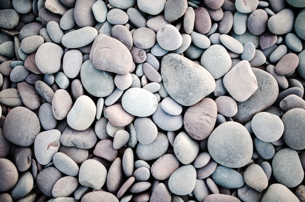 blue and gray stones on brown soil