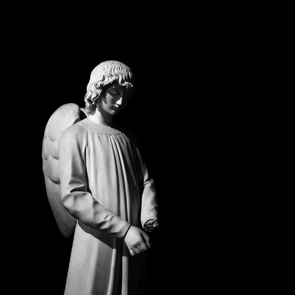 gray scale photo of angel statue