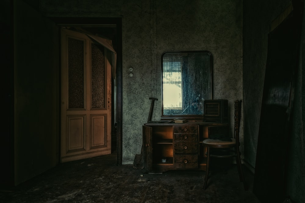 brown wooden door near brown wooden desk