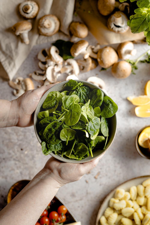 green leaves on white ceramic bowl