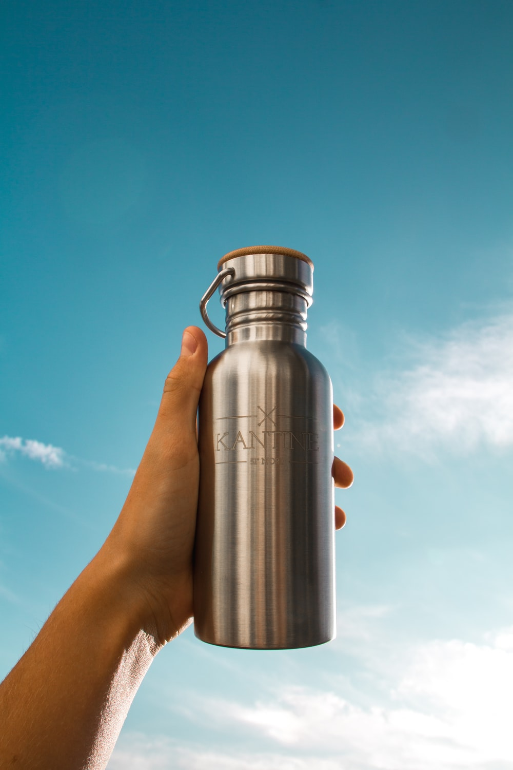 stainless steel vacuum flask on persons hand